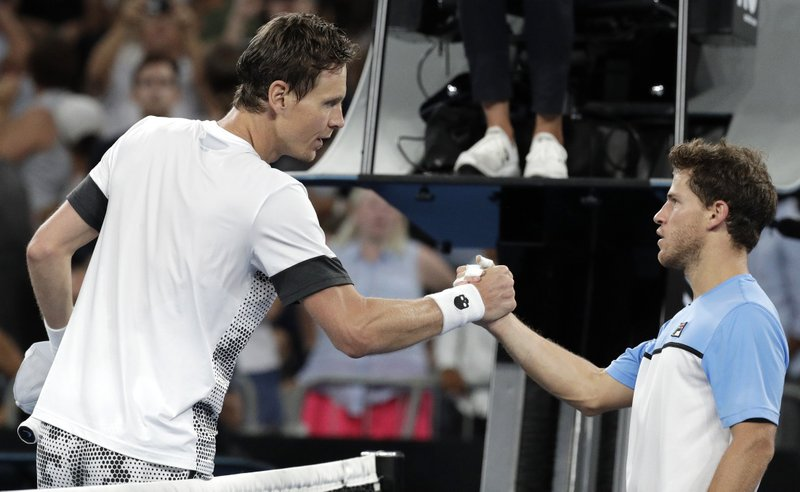 Tomas Berdych, left, of the Czech Republic is congratulated by Argentina's Diego Schwartzman after winning their third round match at the Australian Open tennis championships in Melbourne, Australia, Friday, Jan. (AP Photo/Aaron Favila)