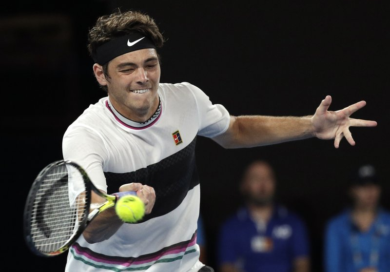 United States' Taylor Fritz plays a forehand return to Switzerland's Roger Federer during their third round match at the Australian Open tennis championships in Melbourne, Australia, Friday, Jan. (AP Photo/Kin Cheung)