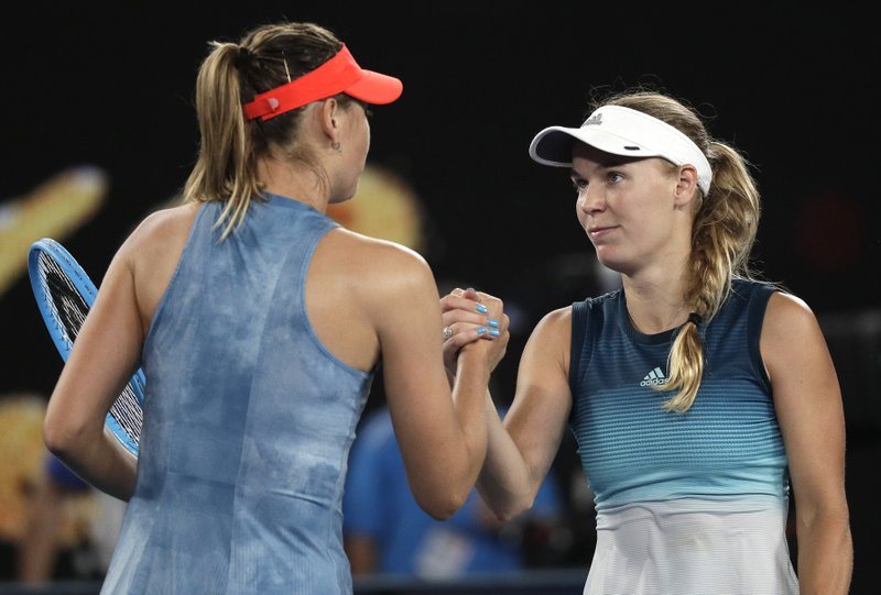 Russia's Maria Sharapova, left, is congratulated by Denmark's Caroline Wozniacki after winning their third round match at the Australian Open tennis championships in Melbourne, Australia, Friday, Jan. (AP Photo/Kin Cheung)