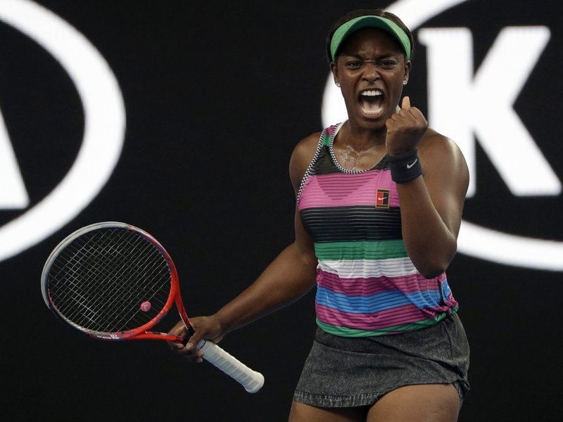 United States' Sloane Stephens celebrates after winning the first set against Croatia's Petra Martic during their third round match at the Australian Open tennis championships in Melbourne, Australia, Friday, Jan. (AP Photo/Mark Schiefelbein)