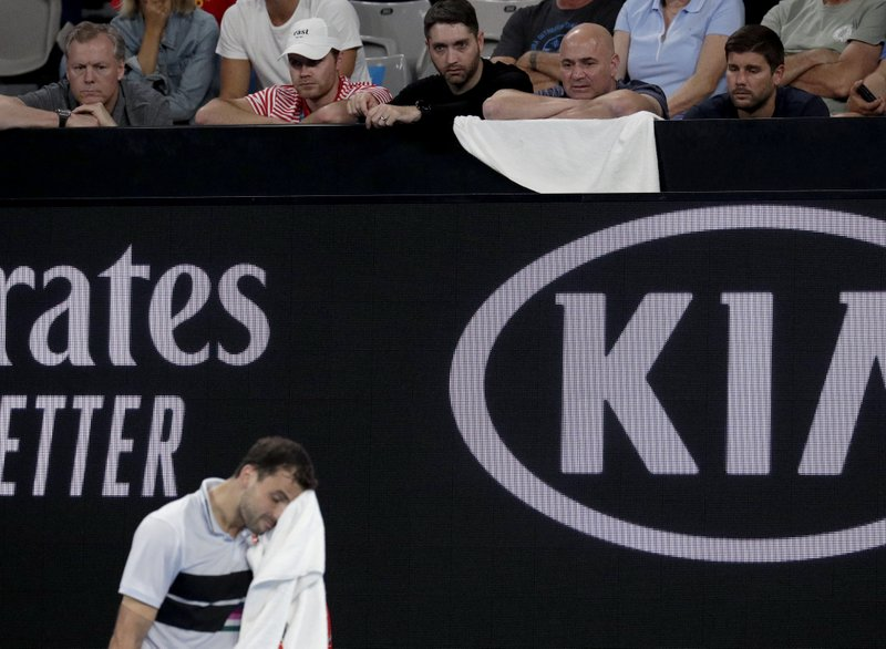 Andre Agassi, coach of Bulgaria's Grigor Dimitrov watches his third round match against Italy's Thomas Fabbiano at the Australian Open tennis championships in Melbourne, Australia, Friday, Jan. (AP Photo/Aaron Favila)