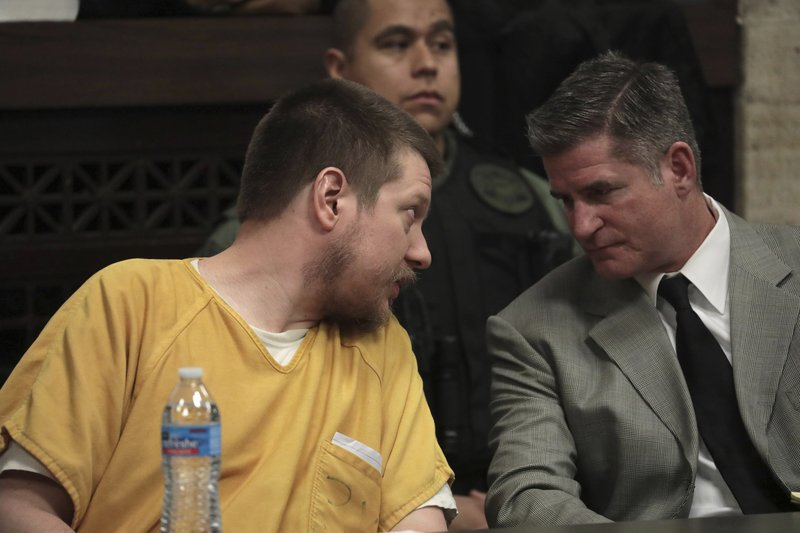 Former Chicago police Officer Jason Van Dyke confers with his attorney Daniel Herbert during his sentencing hearing for the 2014 shooting of Laquan McDonald at the Leighton Criminal Court Building, Friday, Jan. (Antonio Perez/Chicago Tribune via AP, Pool)