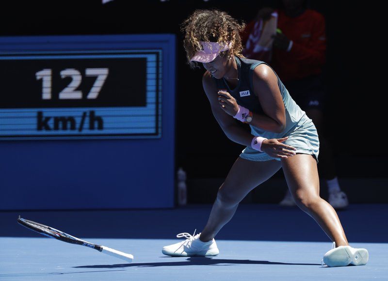 Japan's Naomi Osaka throws her racket in frustration during her third round match against Taiwan's Hsieh Su-Wei at the Australian Open tennis championships in Melbourne, Australia, Saturday, Jan. (AP Photo/Kin Cheung)