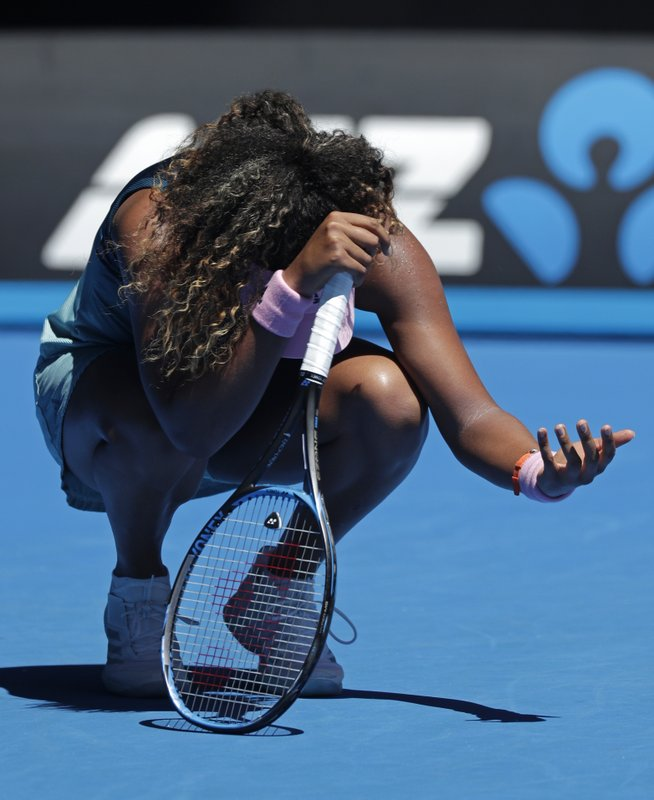 Japan's Naomi Osaka reacts after losing a point against Taiwan's Hsieh Su-Wei during in third round match at the Australian Open tennis championships in Melbourne, Australia, Saturday, Jan. (AP Photo/Kin Cheung)
