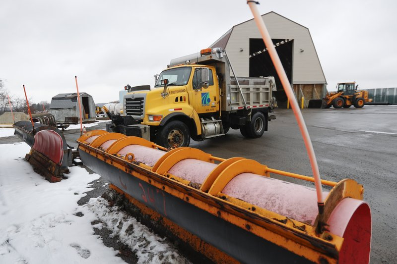 A Pennsylvania Department of Transportation road treatment truck pulls in to attach a plow at a storage facility in Franklin Park, Pa. (AP Photo/Keith Srakocic)