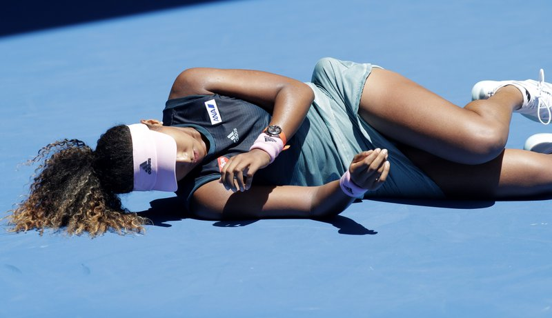 Japan's Naomi Osaka falls during her third round match against Taiwan's Hsieh Su-Wei at the Australian Open tennis championships in Melbourne, Australia, Saturday, Jan. (AP Photo/Kin Cheung)