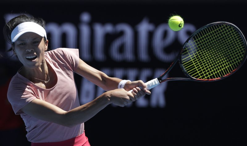 Taiwan's Hsieh Su-Wei makes a backhand return to Japan's Naomi Osaka during their third round match at the Australian Open tennis championships in Melbourne, Australia, Saturday, Jan. (AP Photo/Kin Cheung)