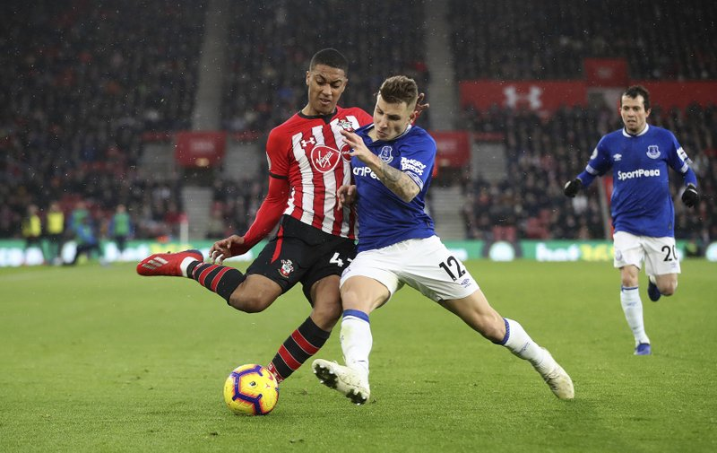 Southampton's Yan Valery, left, and Everton's Lucas Digne vie for the ball, during the English Premier League  soccer match between Southampton and Everton at St Mary's, Southampton, England, Saturday, Jan. (Adam Davy/PA via AP)