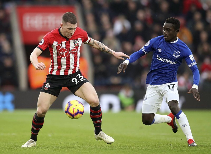 Southampton's Pierre-Emile Hojbjerg, left, vies for the ball with Everton's Idrissa Gueye during the English Premier League  soccer match between Southampton and Everton at St Mary's, Southampton, England, Saturday, Jan. (Adam Davy/PA via AP)