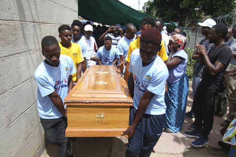 Soccer teammates of Kelvin Tinashe Choto carry his coffin, during his funeral in Chitungwiza, about 30 kilometres south east of the capital, Harare, Zimbabwe, Saturday, Jan, 19, 2019. (AP Photo/Tsvangirayi Mukwazhi)