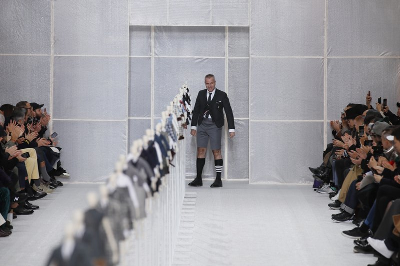 Designer Thom Browne accepts applause after his men's Fall/Winter 2019/20 fashion collection presented in Paris, Saturday Jan. (AP Photo/Francois Mori)