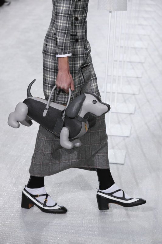 A model wears a creation for the Thom Browne men's Fall/Winter 2019/20 fashion collection presented in Paris, Saturday Jan. (AP Photo/Francois Mori)