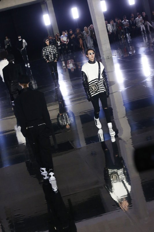 Models wear creations for the Balmain men's Fall/Winter 2019/20 fashion collection presented in Paris, Friday Jan. (AP Photo/Michel Euler)