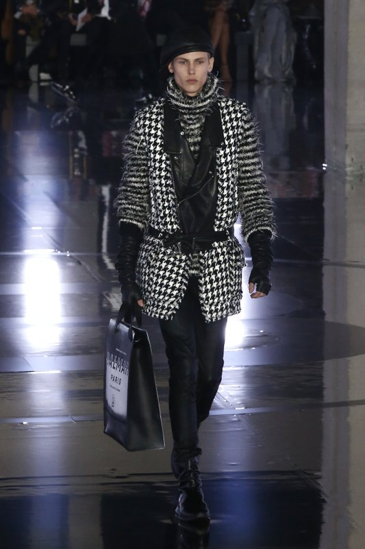 A model wears a creation for the Balmain men's Fall/Winter 2019/20 fashion collection presented in Paris, Friday Jan. (AP Photo/Michel Euler)