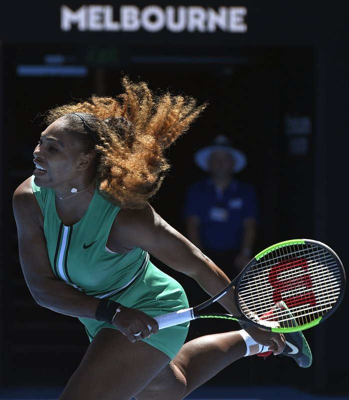 United States' Serena Williams serves to Ukraine's Dayana Yastremska during their third round match at the Australian Open tennis championships in Melbourne, Australia, Saturday, Jan. (AP Photo/Andy Brownbill)