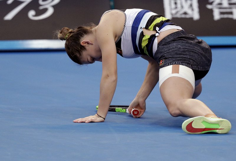 Romania's Simona Halep falls during her third round match against United States' Venus Williams at the Australian Open tennis championships in Melbourne, Australia, Saturday, Jan. (AP Photo/Kin Cheung)
