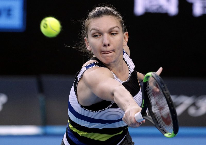 Romania's Simona Halep makes a backhand return to United States' Venus Williams during their third round match at the Australian Open tennis championships in Melbourne, Australia, Saturday, Jan. (AP Photo/Kin Cheung)