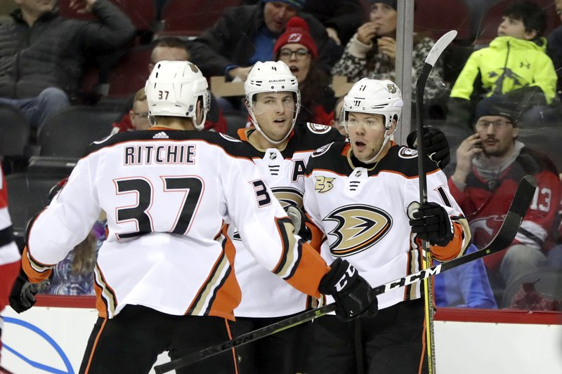 Anaheim Ducks right wing Daniel Sprong, right, of the Netherlands, celebrates his goal with teammates Nick Ritchie (37) and Cam Fowler (4) against the New Jersey Devils during the first period of an NHL hockey game, Saturday, Jan. (AP Photo/Julio Cortez)