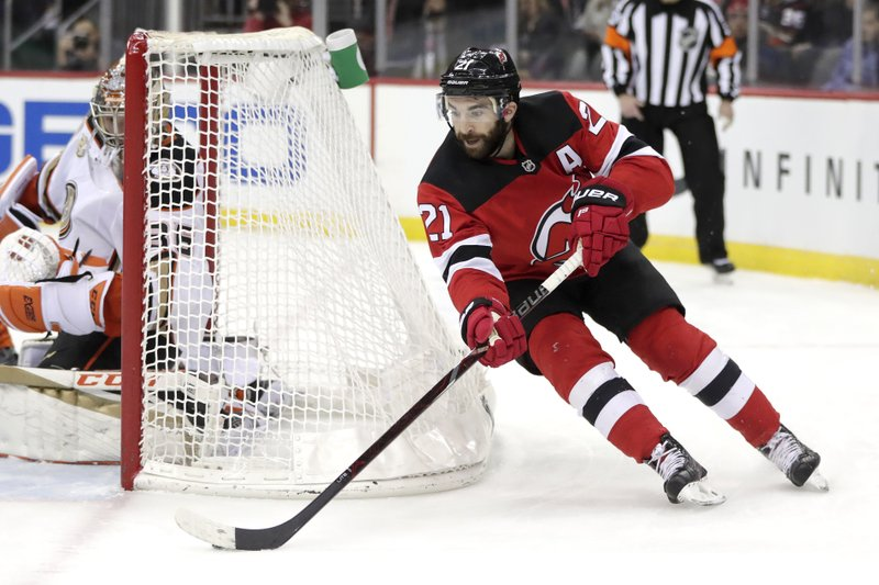 New Jersey Devils right wing Kyle Palmieri skates against the Anaheim Ducks during the second period of an NHL hockey game, Saturday, Jan. (AP Photo/Julio Cortez)