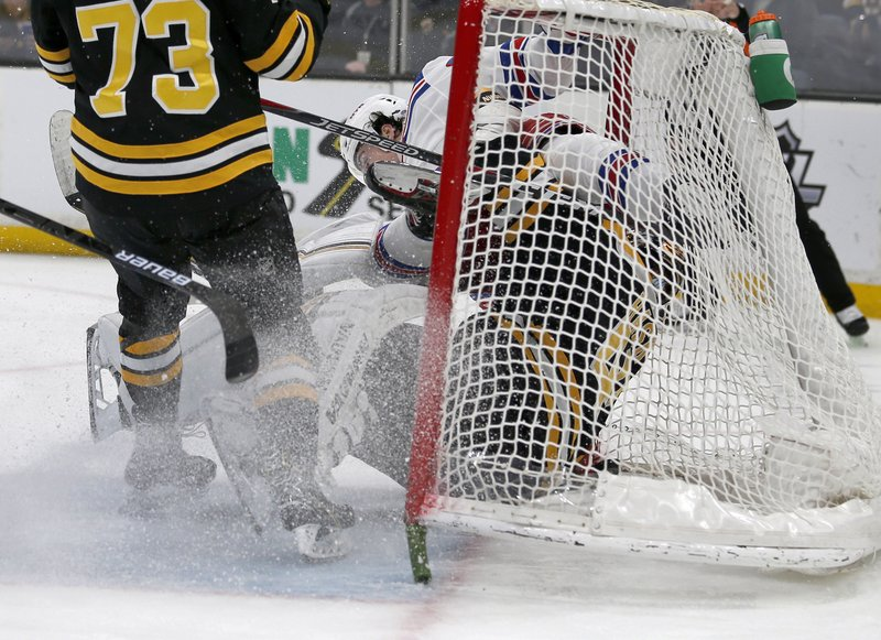New York Rangers center Filip Chytil scores as he collides with Boston Bruins goaltender Tuukka Rask (40) ahead of Charlie McAvoy (73) during the first period of an NHL hockey game, Saturday, Jan. (AP Photo/Mary Schwalm)