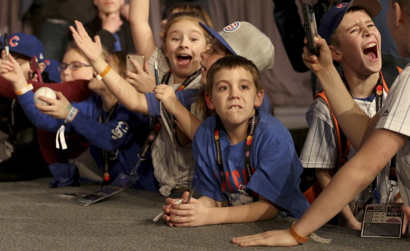 Young fans react as players appear during the Chicago Cubs' annual fan convention in Chicago on Friday Jan. (Patrick Kunzer/Daily Herald via AP)