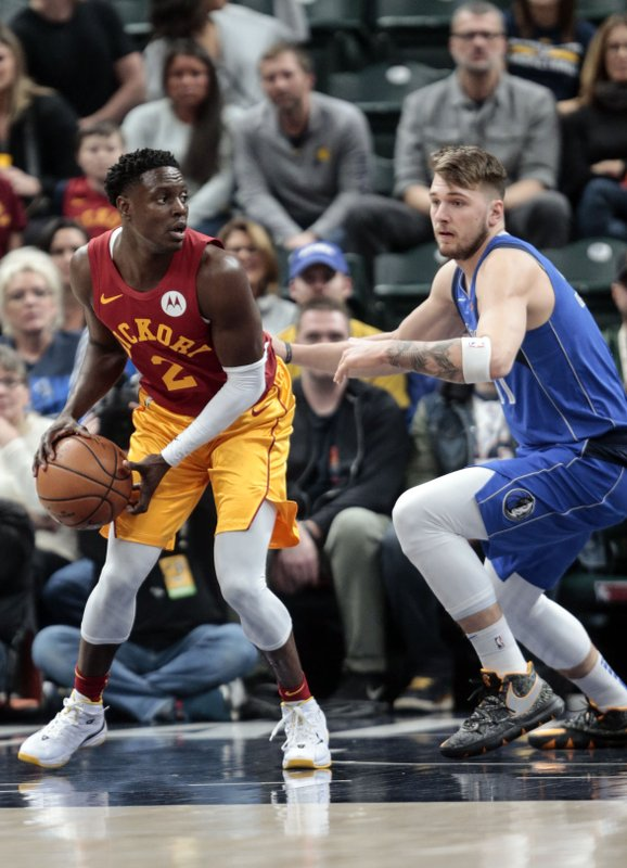 Indiana Pacers guard Darren Collison, left, look to pass the ball around Dallas Mavericks guard Luka Doncic during the first half of an NBA basketball game in Indianapolis, Saturday, Jan. (AP Photo/AJ Mast)