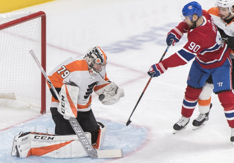 Montreal Canadiens' Tomas Tatar (90) moves in on Philadelphia Flyers goaltender Carter Hart during the third period of an NHL hockey game in Montreal, Saturday, Jan. (Graham Hughes/The Canadian Press via AP)