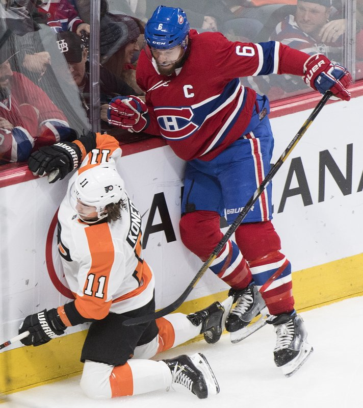 Philadelphia Flyers' Travis Konecny (11) collides with Montreal Canadiens' Shea Weber during the second period of an NHL hockey game in Montreal, Saturday, Jan. (Graham Hughes/The Canadian Press via AP)