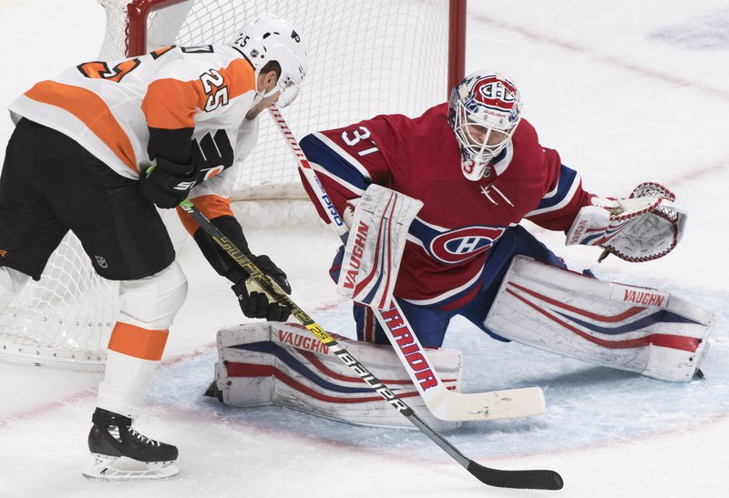 Philadelphia Flyers' James van Riemsdyk moves in on Montreal Canadiens goaltender Antti Niemi during the second period of an NHL hockey game in Montreal, Saturday, Jan. (Graham Hughes/The Canadian Press via AP)