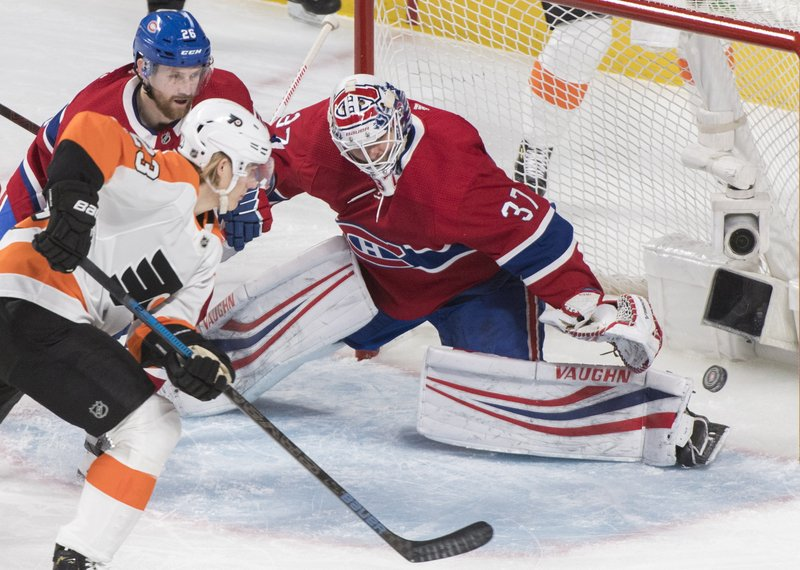 Philadelphia Flyers' Oskar Lindblom (23) moves in on Montreal Canadiens goaltender Antti Niemi as Canadiens' Jeff Petry (26) defends during the first period of an NHL hockey game in Montreal, Saturday, Jan. (Graham Hughes/The Canadian Press via AP)