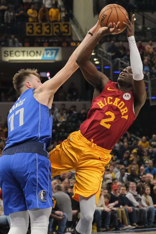 Indiana Pacers guard Darren Collison (2) is fouled while shooting by Dallas Mavericks forward Luka Doncic (77)during the second half of an NBA basketball game in Indianapolis, Saturday, Jan. (AP Photo/AJ Mast)