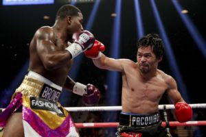 Pacquiao dominates in retaining title against Broner