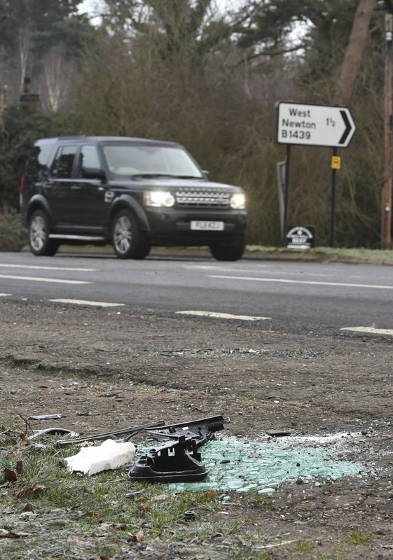 Broken glass and car parts on the road side near to the Sandringham Estate, England, where Prince Philip was involved in a road accident Thursday while he was driving, Friday Jan. (John Stillwell/PA via AP)
