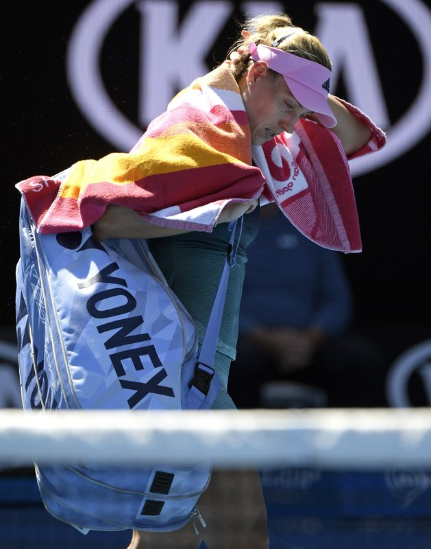 Germany's Angelique Kerber leaves the court after losing her fourth round match to United States' Danielle Collins at the Australian Open tennis championships in Melbourne, Australia, Sunday, Jan. (AP Photo/Andy Brownbill)