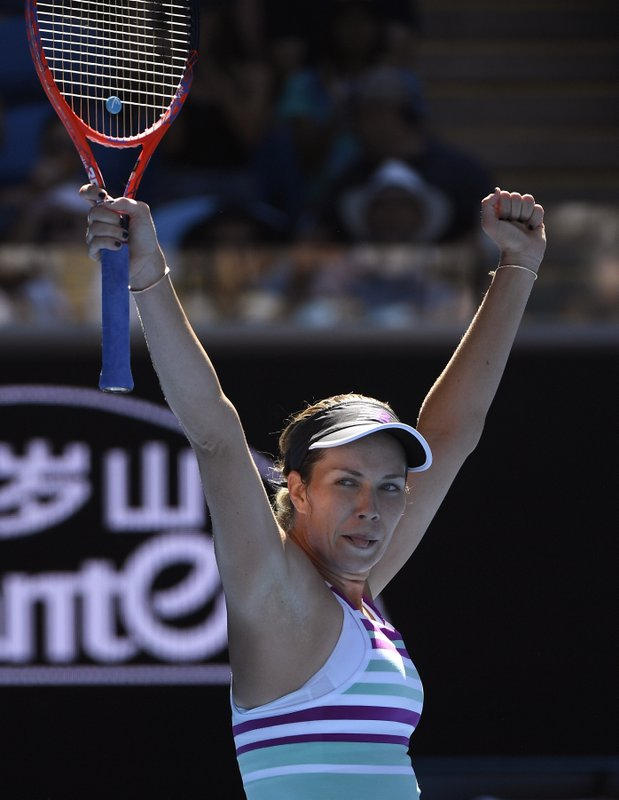 United States' Danielle Collins celebrates after defeating Germany's Angelique Kerber during their fourth round match at the Australian Open tennis championships in Melbourne, Australia, Sunday, Jan. (AP Photo/Andy Brownbill)