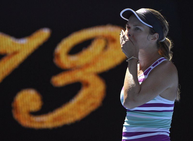 United States' Danielle Collins reacts after defeating Germany's Angelique Kerber during their fourth round match at the Australian Open tennis championships in Melbourne, Australia, Sunday, Jan. (AP Photo/Andy Brownbill)