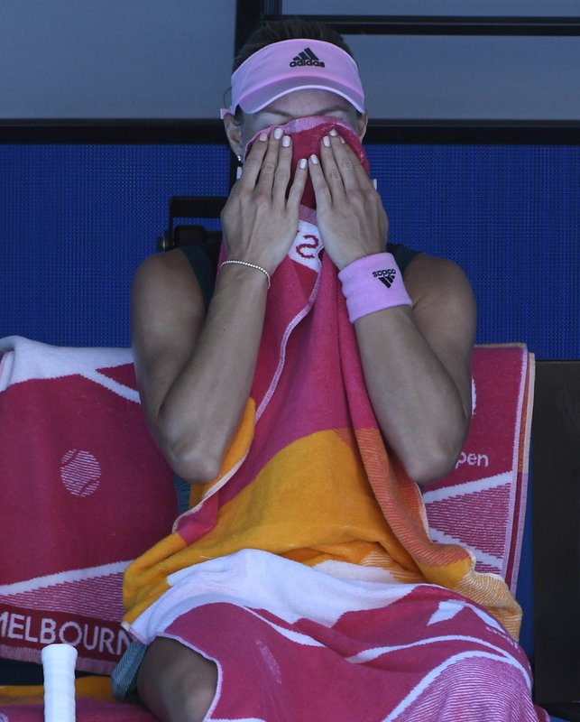 Germany's Angelique Kerber wipes the sweat from her face during her fourth round match against United States' Danielle Collins at the Australian Open tennis championships in Melbourne, Australia, Sunday, Jan. (AP Photo/Andy Brownbill)