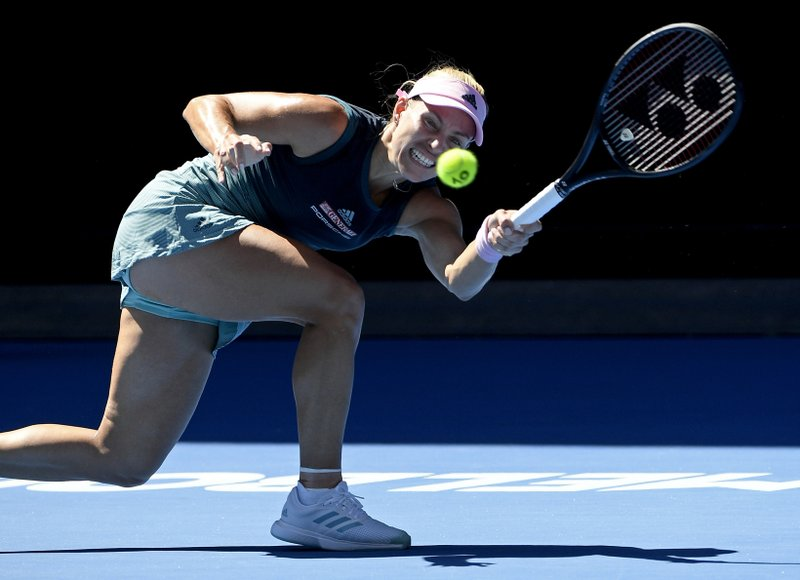 Germany's Angelique Kerber makes a forehand return to United States' Danielle Collins during their fourth round match at the Australian Open tennis championships in Melbourne, Australia, Sunday, Jan. (AP Photo/Andy Brownbill)