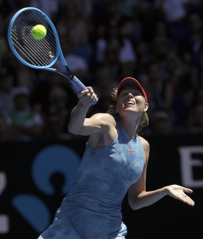 Russia's Maria Sharapova makes a forehand return to Australia's Ashleigh Barty during their fourth round match at the Australian Open tennis championships in Melbourne, Australia, Sunday, Jan. (AP Photo/Mark Schiefelbein)