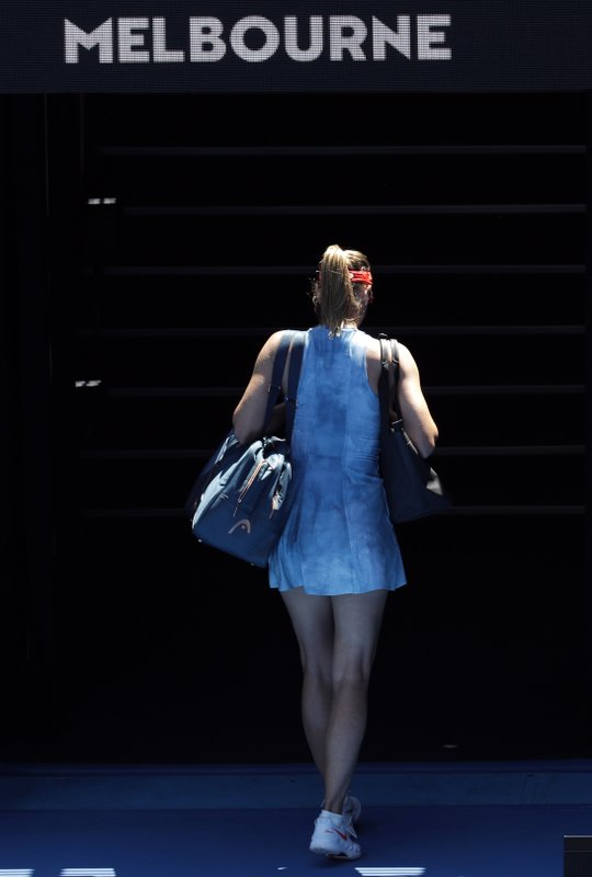 Russia's Maria Sharapova leaves Rod Laver Arena after losing her fourth round match to Australia's Ashleigh Barty at the Australian Open tennis championships in Melbourne, Australia, Sunday, Jan. (AP Photo/Aaron Favila)