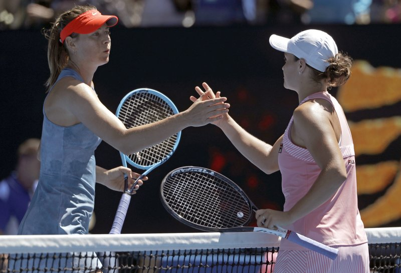 Australia's Ashleigh Barty, right, is congratulated by Russia's Maria Sharapova after winning their fourth round match at the Australian Open tennis championships in Melbourne, Australia, Sunday, Jan. (AP Photo/Mark Schiefelbein)