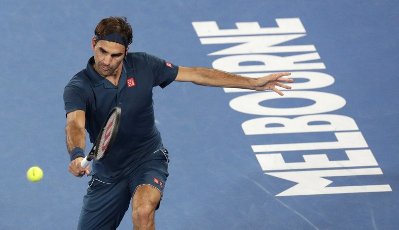 Switzerland's Roger Federer makes a backhand return to Greece's Stefanos Tsitsipas during their fourth round match at the Australian Open tennis championships in Melbourne, Australia, Sunday, Jan. (AP Photo/Aaron Favila)