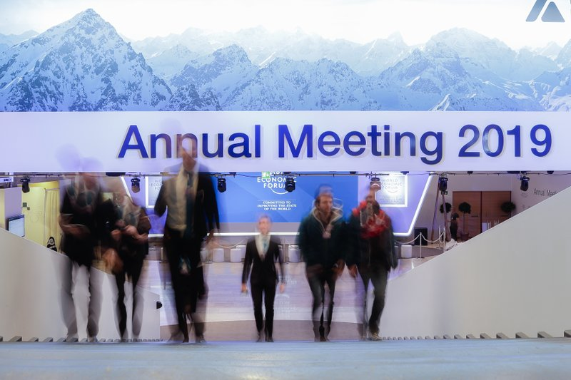 People walk up stairs at the congress center where the annual meeting of the World Economic Forum 2019, WEF, take place in Davos, Sunday, Jan. (AP Photo/Markus Schreiber)