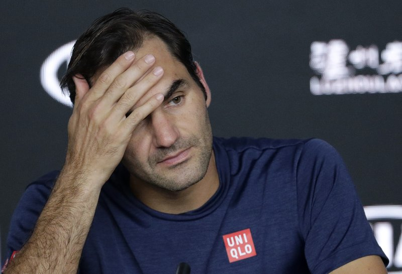 Switzerland's Roger Federer answers questions at a press conference following his fourth round loss to Greece's Stefanos Tsitsipas at the Australian Open tennis championships in Melbourne, Australia, Sunday, Jan. (AP Photo/Aaron Favila)