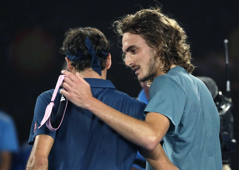Greece's Stefanos Tsitsipas, right, is congratulated by Switzerland's Roger Federer after winning their fourth round match at the Australian Open tennis championships in Melbourne, Australia, Sunday, Jan. (AP Photo/Mark Schiefelbein)
