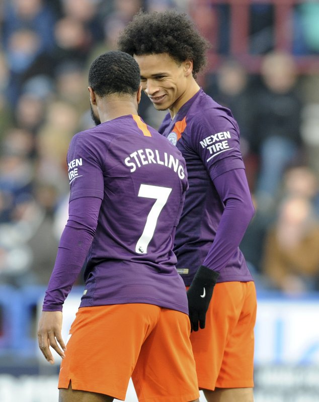 Manchester City's Raheem Sterling, left, celebrates with his teammate Leroy Sane, after scoring his team's second goal, during the English Premier League soccer match between Huddersfield Town and Manchester City at John Smith's stadium in Huddersfield, England, Sunday, Jan. (AP Photo/Rui Vieira)