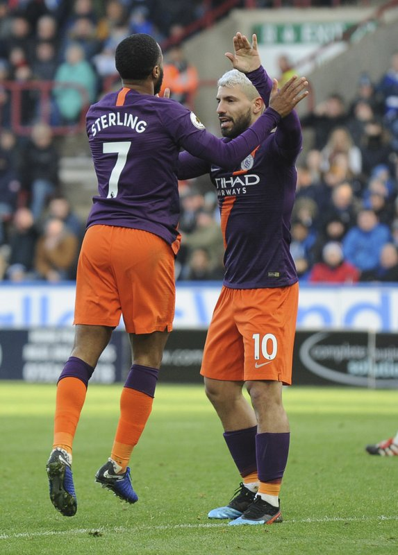 Manchester City's Raheem Sterling, left, celebrates teammate Sergio Aguero, after scoring the second goal for his team, during the English Premier League soccer match between Huddersfield Town and Manchester City at John Smith's stadium in Huddersfield, England, Sunday, Jan. (AP Photo/Rui Vieira)