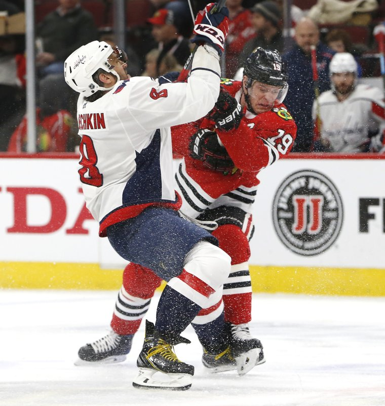 Left Washington Capitals left wing Alex Ovechkin (8) and Chicago Blackhawks center Jonathan Toews (19) battle for the puck during the first period of an NHL hockey game Sunday, Jan. (AP Photo Nuccio DiNuzzo)