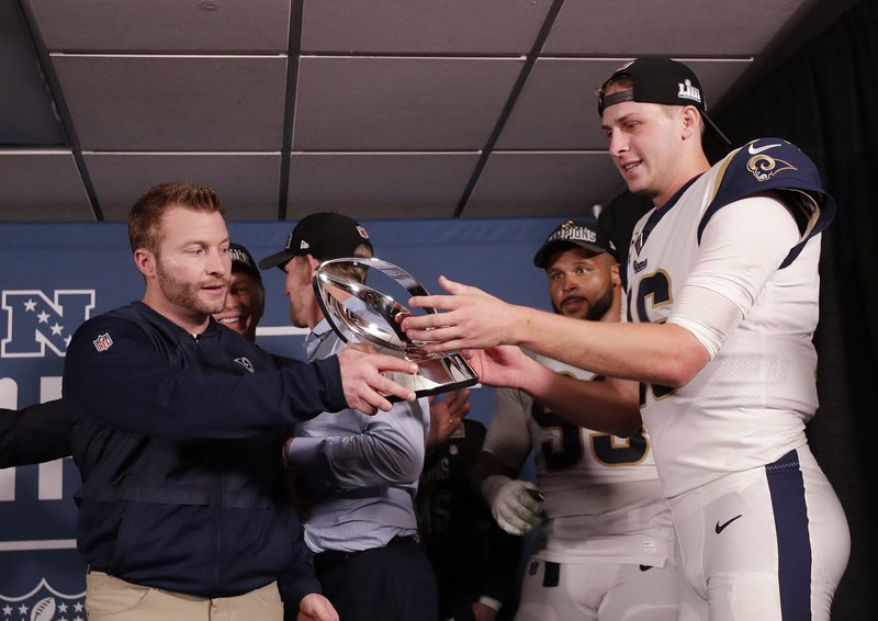 Los Angeles Rams head coach Sean McVay and Los Angeles Rams quarterback Jared Goff hold the NFC Championship trophy after overtime of the NFL football NFC championship game against the New Orleans Saints, Sunday, Jan. (AP Photo/David J. Phillip)