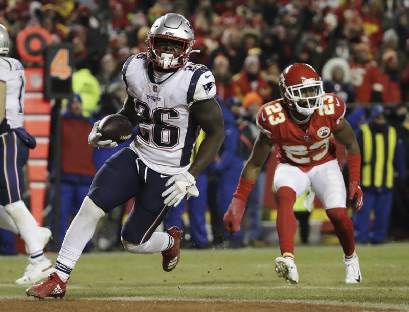 New England Patriots running back Sony Michel (26) runs to the end zone for a touchdown during the second half of the AFC Championship NFL football game against the Kansas City Chiefs, Sunday, Jan. (AP Photo/Elise Amendola)